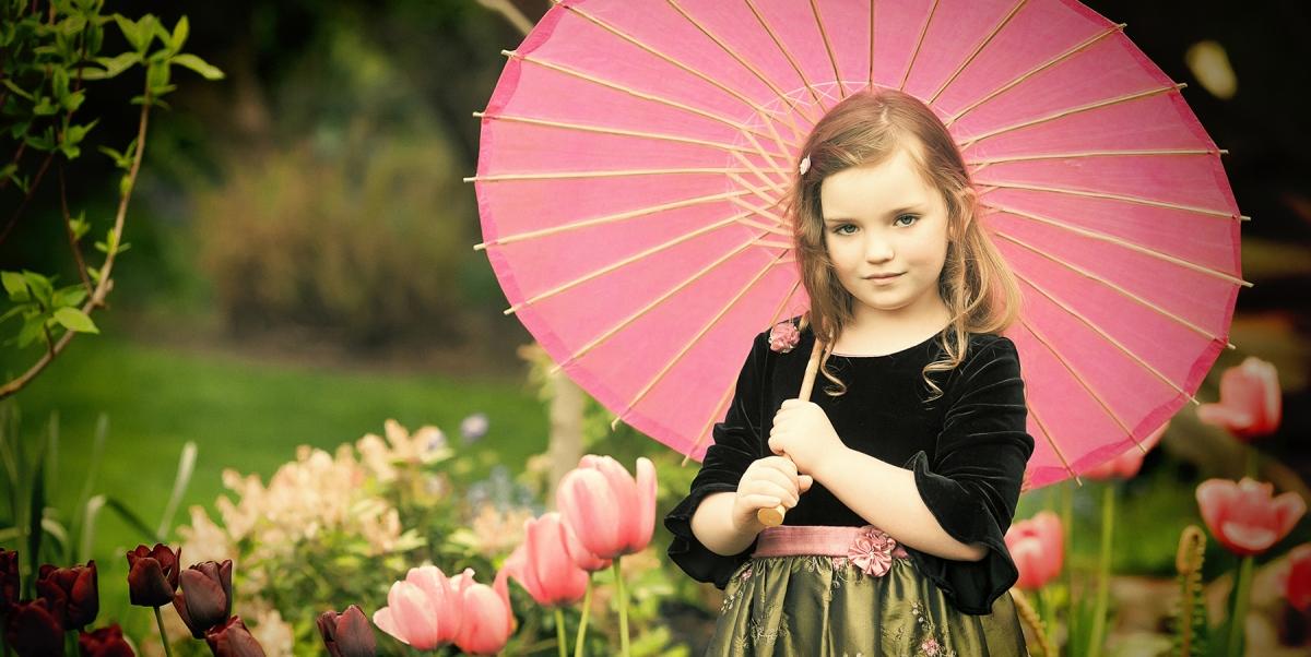 Garden portraits, spring portraits, little girl in garden with umbrella