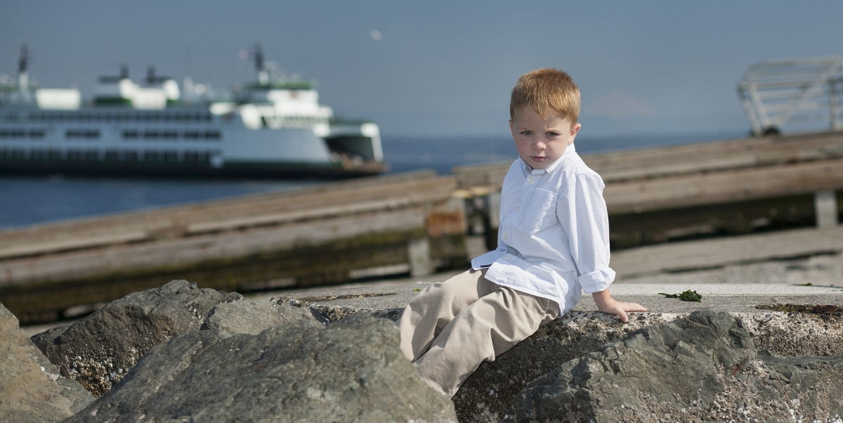 Boy at the beach, beach portraits, boy on rock portrait